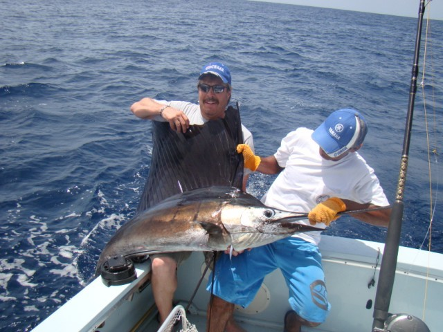 fishing charters tours costa rica pacific coast sail fish with happy fishermen - big